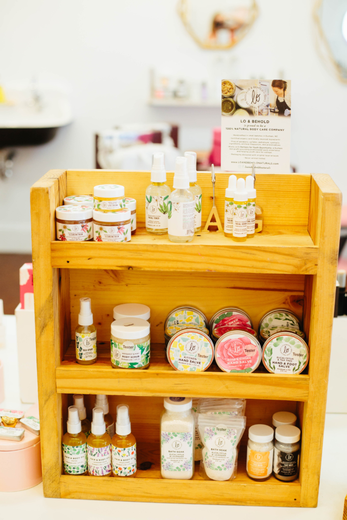 Photo of Lo & Behold display made of reclaimed wood with natural products on it