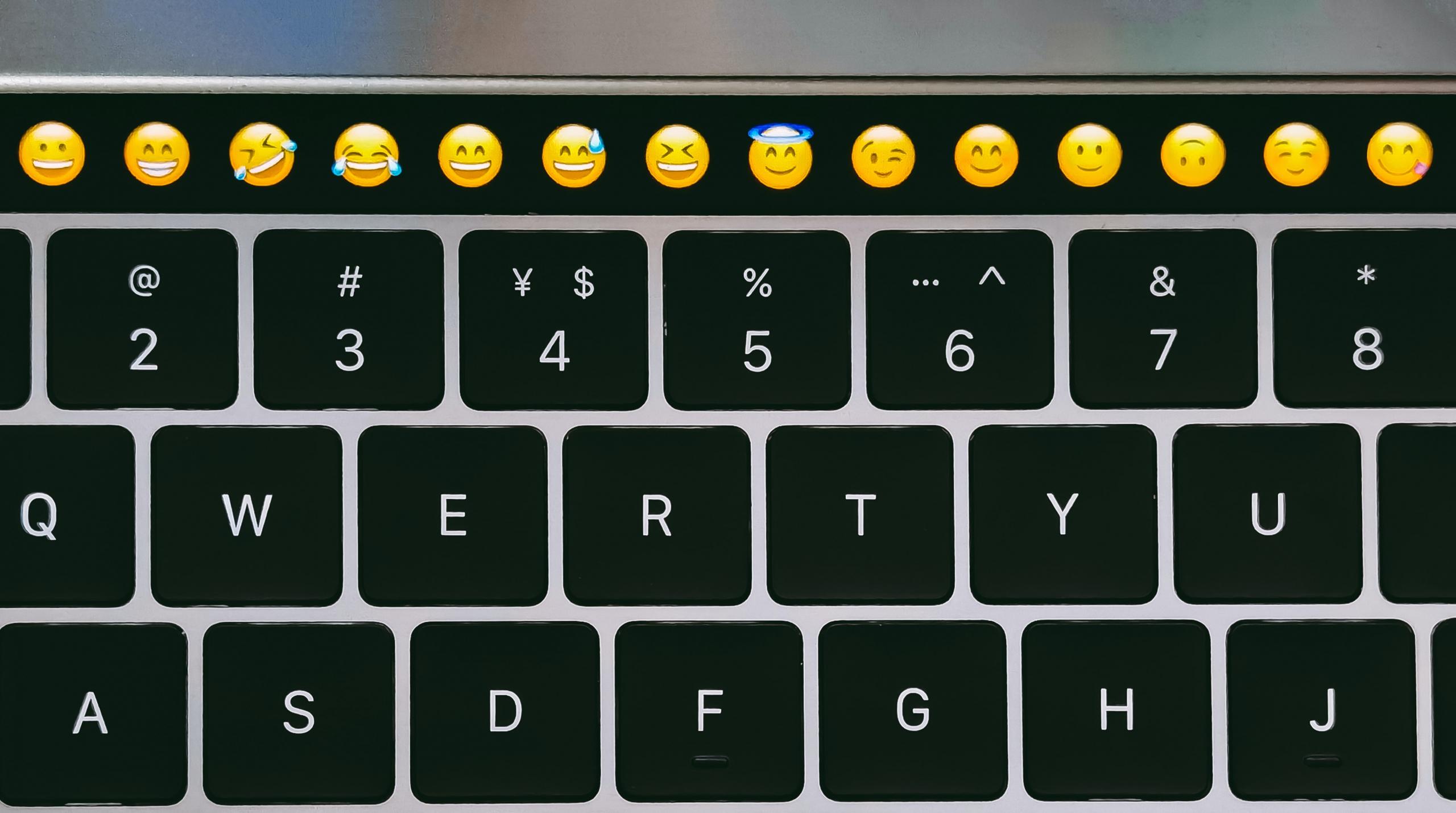 Emojis on top bar of laptop